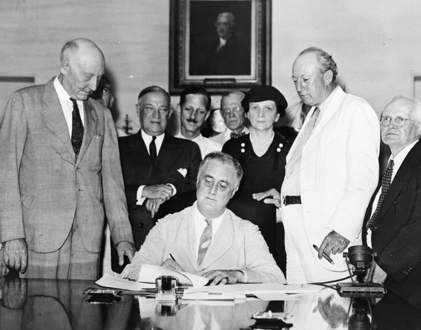 Roosevelt signs Social Security Bill
